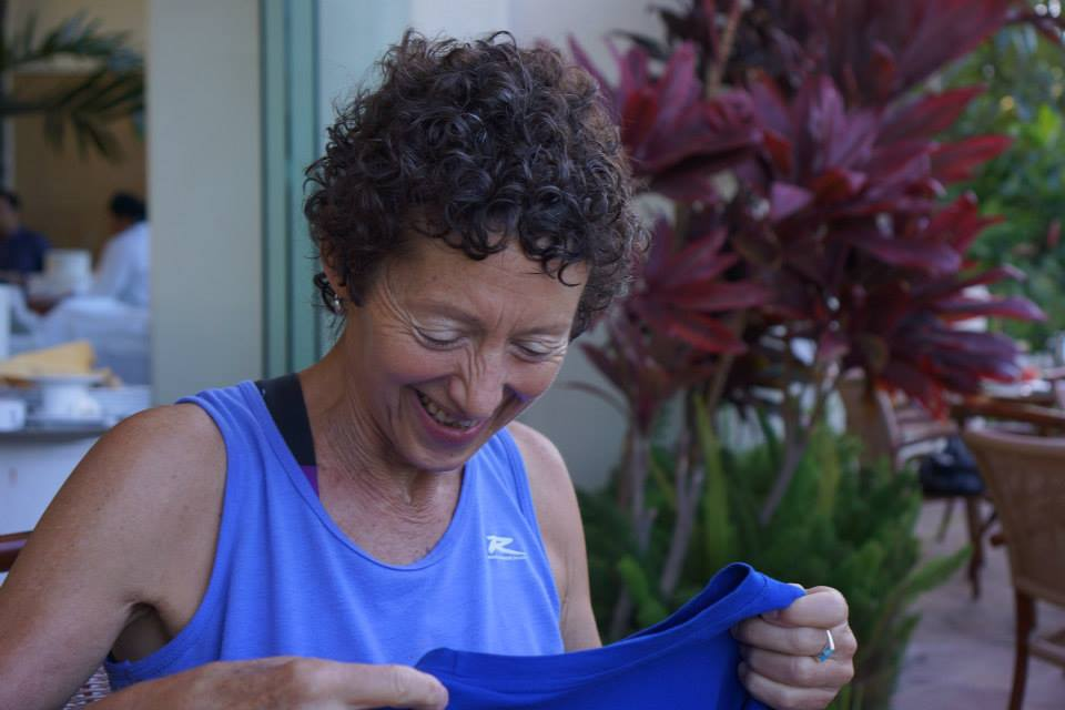 me laughing looking a a blue shirt
