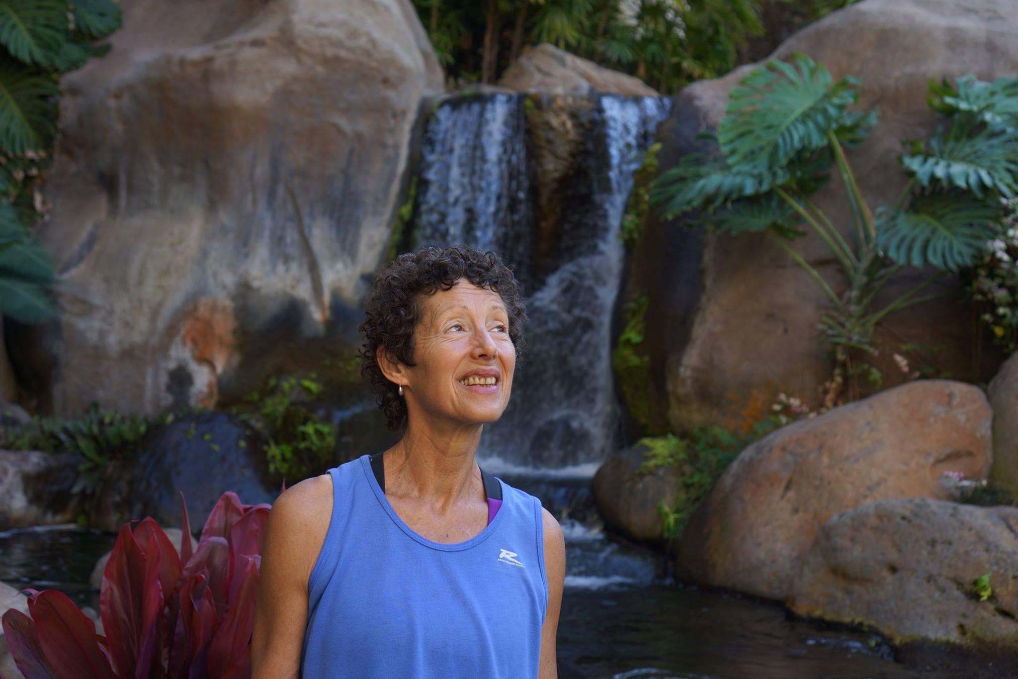 Nancy in front of Maui waterfall