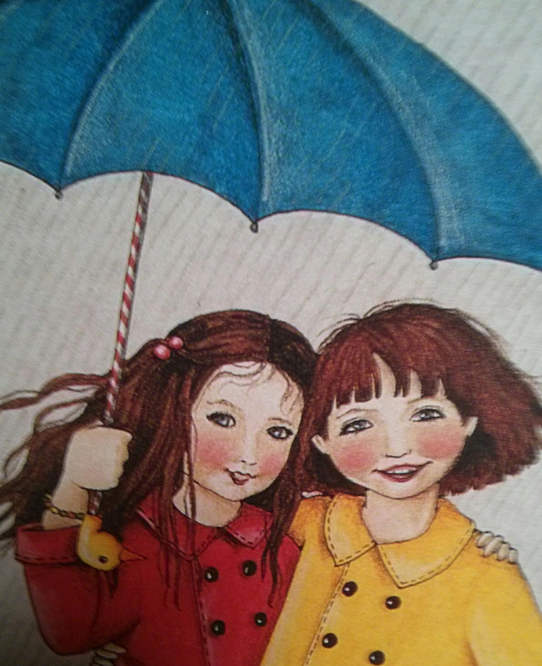 friends sharing an umbrella