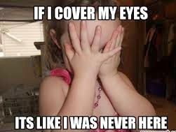 child covering her eyes