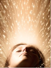 dreamy woman surrounded by sparks of light