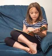 girl on couch reading