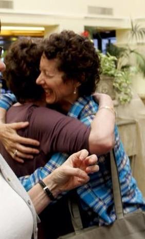 me joyfully hugging a friend