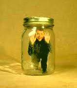 man trapped inside a jar