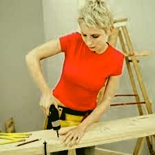 woman working with an electric drill
