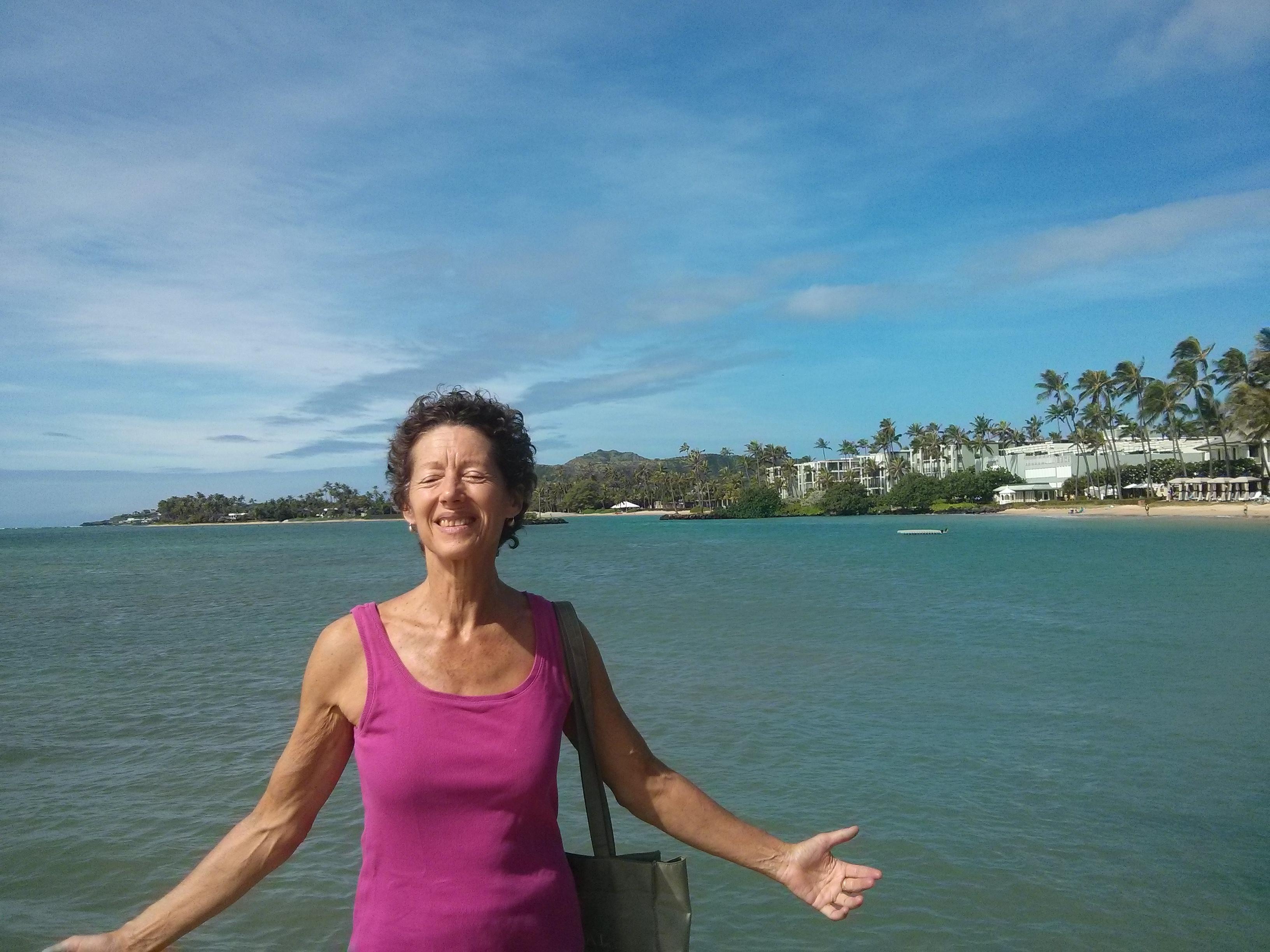 Nancy embracing Hawaii strong sun and wind